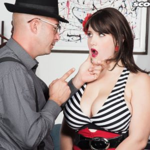 Black-haired MILF May West having big boobs and rigid swell nips uncovered by dude in hat