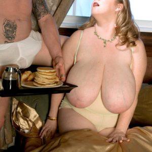 Blonde feeder Sapphire exposing big funbags before giving handjob while licking