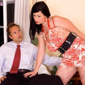 Brunette MILF pornstar Terry Nova giving handjob and blowjob in mesh bodystocking