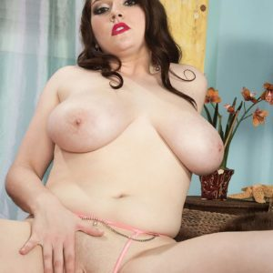 Dark haired MILF Kate Marie pulling out monster-sized all natural breasts while undressing