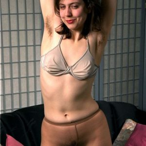 European amateur baring truly hairy vag from white underwear and hose