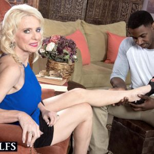 Leggy older blonde lady Cammille Austin prepping for sex with big black cock