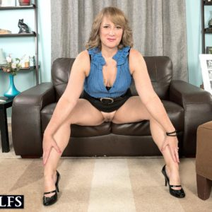 MILF over 50 Catrina Costa seducing man in glasses wearing short microskirt and high-heels