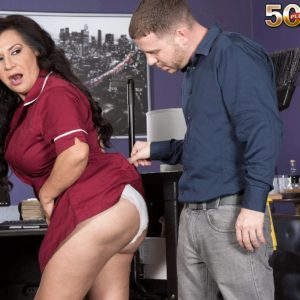 Over 50 brunette cleaning lady Victoria Versaci tit fucking and sucking cock in office