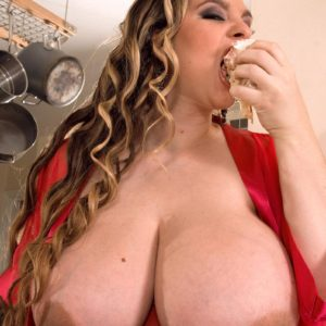 Over weight girl April McKenzie showcasing immense fun bags while slurping dick and eating food