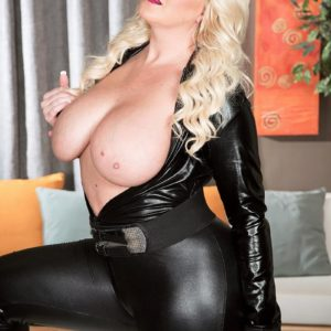 Plumper blond model Holly sausage letting giant all-natural titties free from leather outfit