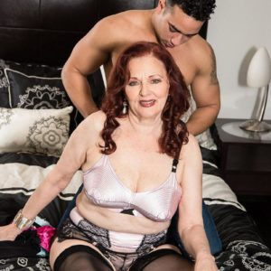 Redhead MILF over sixty Katherine Merlot baring big saggy breasts for nip play
