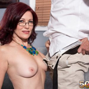 Senior doll Dana Devereaux seducing younger stud for sex attired glasses