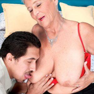 Short haired grandma Joanne Price seducing junior man in hosiery and garter
