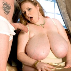 Yellow-haired feeder Sapphire revealing huge hooters before delivering hand-job while munching