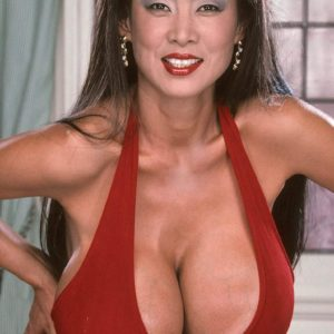 Asian MILF adult film starlet Minka revealing huge hooters from red sundress in heels
