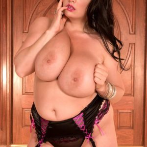 Curvaceous black-haired MILF Arianna Sinn letting gigantic funbags loose from boulder-holder in tights