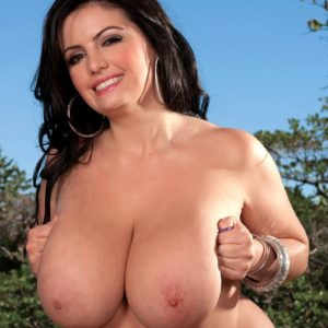 Dark haired giant hooter model Arianna Sinn displaying big all-natural fun bags outdoors