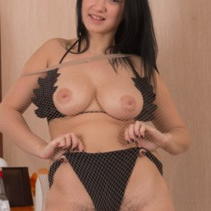First-timer dark-haired baring humungous all natural juggs from bathing suit and parting fur covered beaver