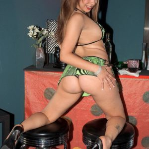 Latina MILF XXX film star Tia Sweets displaying monster-sized backside in thong and high heels