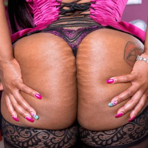 Overweight black solo female Virgin Blossoms displaying gigantic ass in nylons and lingerie