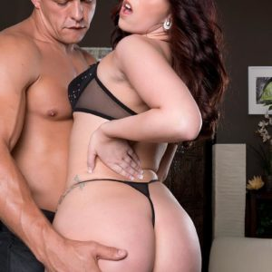 Dark haired MILF Ryan Sneers demonstrating large tush in g-string panties and high-heeled shoes