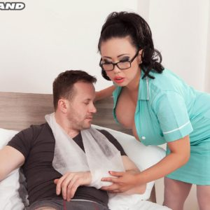 Dark-haired MILF Tigerr Benson unleashing enormous funbags before having sex on hospital bed