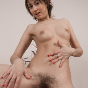 Lean black-haired amateur with diminutive fun bags parting fur covered honeypot after disrobing