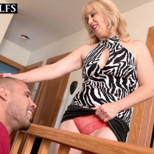 Mature platinum-blonde cougar Rebecca Williams seducing junior man for sex on bed