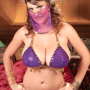 MILF pornstar Valory Irene strutting invitingly non naked in harem girl uniform