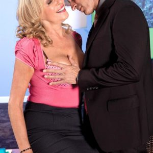 Big-chested light-haired MILF over 60 Bethany James giving big knob oral jobs in work place
