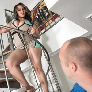 BIG hot woman Cat Bangles demonstrating no panty upskirt on stairs before uncovering big knockers