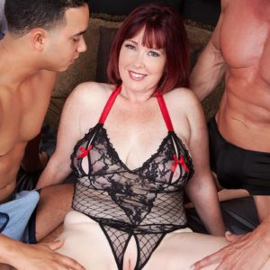 Buxom ginger-haired MILF Heather Barron boinking two giant pricks during MMF 3some