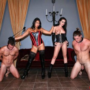Dark-haired Dominas Adriana Lynn and Mia Li abuse collared and nude boy slaves