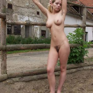 Female next door type rides her pony in the naked before showing furry cooch in field