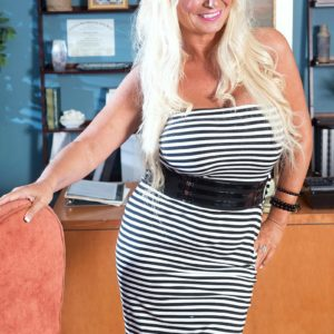 Mature platinum-blonde gal Annellise Croft flaunting massive boobs in front of cuck