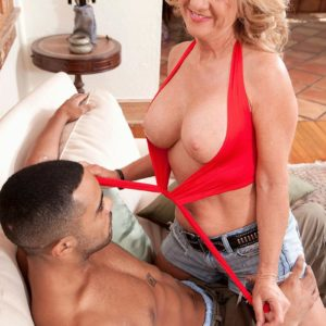Senior golden-haired broad Cali Houston unveiling enormous funbags while seducing junior dude