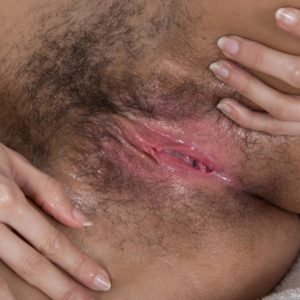 Gawky brunette first-timer Tracy Rose oiling fur covered snatch for spreading of labia lips