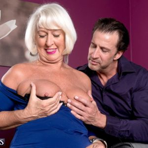 Fully-clothed 60 plus MILF Jeannie Lou extracting massive mature melons in crotchless undies