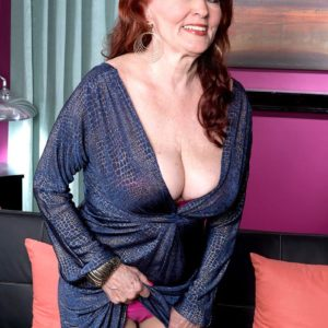 Redhead granny Katherine Merlot revealing big all-natural breasts to tempt sex