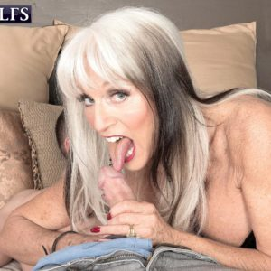 Stripper boot and latex clad mature porno star Sally D'Angelo wanking and licking massive cock