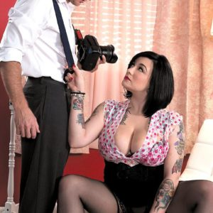 Chubber black-haired stunner Scarlet LaVey vaunting tattoos in lingerie and hose