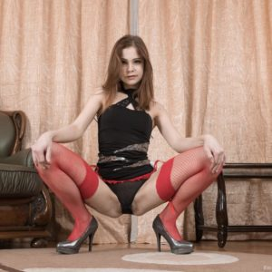Inked first timer Emanuelle showing off furry muff in pantyhose and high heels