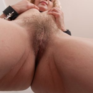 Nice European light-haired Baibira uncovering wooly pussy in submissive dog collar and barefeet