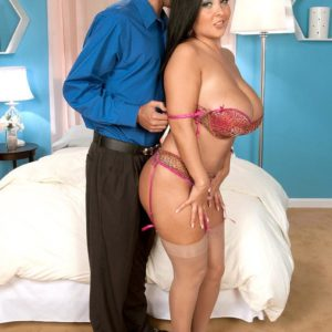 Stocking attired dark-haired babe Daylene Rio having giant boobies and erect nipples fellated
