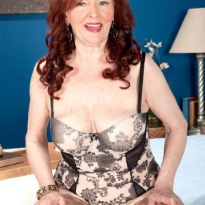 Big-titted redhead grandma Katherine Merlot delivering monster-sized pecker BJ in tights