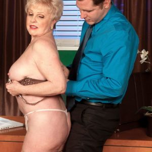 Grannie XXX video starlet Jewel seducing sex from junior boy in work place wearing tan hose
