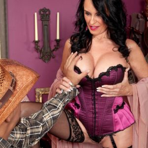 Lingerie and tights adorned experienced adult film star Rita Daniels munching massive penis with tongue