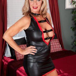 Long legged blonde grandmother Phoenix Skye providing large cock hand-job and oral sex in stilettos