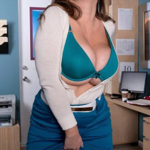 Naughty sandy-haired MILF Janessa Loren letting funbags free from brassiere in home office
