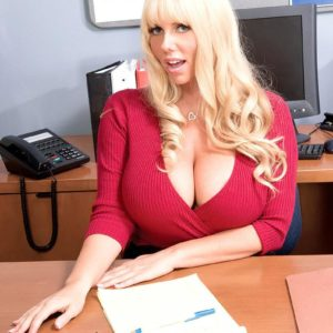 Sandy-haired boss dame Karen Fisher revealing enormous knockers while seducing employee