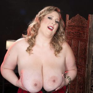Fair-haired BIG SEXY WOMAN Amiee Roberts plays with her immense knockers after pulling them out