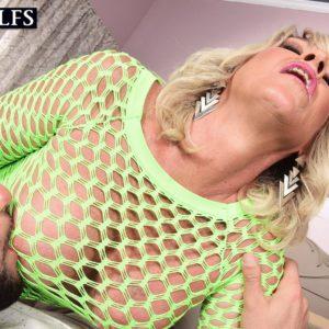 Light-haired cougar Brandi Jaimes seduces a stud in a semi-transparent mesh sundress and high heels