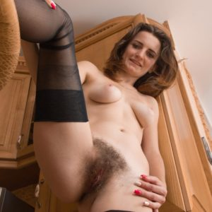 Long legged light-haired amateur in hose exposing lil' boobs and hairy cunny in high heels
