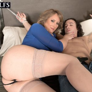 Old platinum-blonde doll Catrina Costa taunts her roped up lover in stockings and stilettos